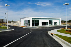 Car dealership site. Newly constructed car dealership and service center building Royalty Free Stock Images