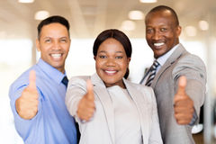 Car dealership staff thumbs up Royalty Free Stock Image