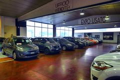 Car dealership for used cars and new Italian cars stock image