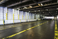 Car deck on ferry. Car deck with cars and trucks on a ferry sailing the Mediterranean Sea stock photo