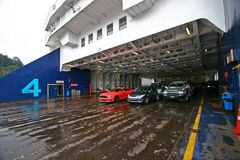 Car deck on ferry on rainy day. Interislander ferry sailing from Wellington to Picton, New Zealand stock image