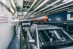 Car deck of MS Silja Symphony with cars and trucks heading to Helsinki Finland. Editorial 03.29.2019 Stockholm Sweden. Car deck of MS Silja Symphony with cars stock photos