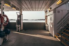 Car Deck on a Small Ferry. Photo from a small car ferry on a winter day with ice outside royalty free stock photo
