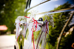Car decorated by and red ribbons Royalty Free Stock Image