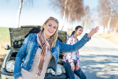 Car defect two women wait for help Royalty Free Stock Image