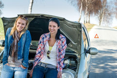 Car defect two women waiting for help Stock Images