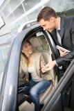 Car delaer handing keys to new owner stock image