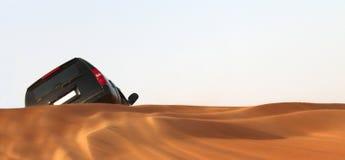 Car in desert. Back view  of black offroad car in desert Royalty Free Stock Photo