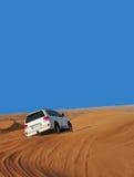 Car in desert. White car in desert with blue sky Stock Image