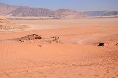 Car on desert Royalty Free Stock Images