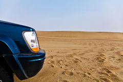 Car in desert Stock Images