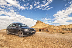 Car in Desert of the Bardenas Reales in Navarre Royalty Free Stock Images