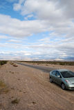 Car on desert road. Car parked on the side of the road in the Nevada desert.  This road leads to the Valley of Fire Stock Photos