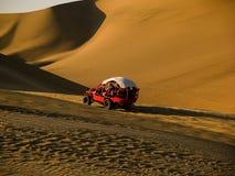 Car in the desert. Walking to an oasis in the desert Car through the desert Stock Photo
