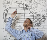 Car Designer. Inventor. Photo compilation, photo and hand-drawing elements combined royalty free stock images
