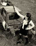 Car destroyed in a crash. And women Royalty Free Stock Photos
