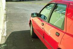 Car Detail. Door of a Car parking next to a Garage royalty free stock image