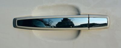 Car detail and Texas. Detail of a white car. Reflections of a Texan landscape and head. Close-up Royalty Free Stock Image