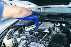 Car detailing maintenance, cleaning engine with hot steam. High pressure washing. Car washing concept. Car detailing. A man cleani. Ng car. Worker cleaning stock photography
