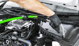 Car detailing maintenance. Cleaning engine with hot steam. High pressure washing. Washing at the station. Car washing concept. Car. Detailing. A man cleaning royalty free stock photo