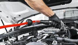 Car detailing maintenance. Cleaning engine with hot steam. High pressure washing. Washing at the station. Car washing concept. Car. Detailing. A man cleaning stock photo
