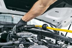 Car detailing maintenance, cleaning engine with hot steam. High pressure washing. Washing at the station. Car washing concept. Car. Detailing. A man cleaning stock images