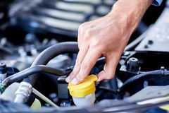 Car detailing series : Cleaning car engine. Close-up engine. Engine detailing in a new car. Car check before purchase. The concept of buying a new car Royalty Free Stock Image