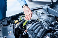 Car detailing series : Cleaning car engine. Close-up engine. Engine detailing in a new car. Car check before purchase. The concept of buying a new car Royalty Free Stock Photo