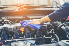 Car detailing series  Cleaning car engine.  Royalty Free Stock Image