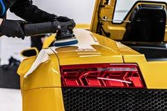 Free Car Detailing Studio Worker Applying Ceramic Coating Stock Photos - 214943223