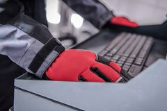 Car Diagnostic Computer. Auto Service Worker Hands on Computer Keyboard stock image