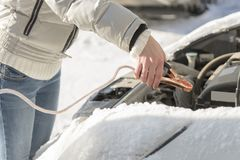 The car did not start because of the cold temperature. The woman Royalty Free Stock Image