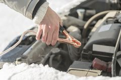 The car did not start because of the cold temperature. The woman Royalty Free Stock Images