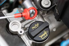 Car dipstick for oil level measurements. Checking the parameters. Of the car engine. Place - workshop Stock Photo
