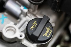 Car dipstick for oil level measurements. Checking the parameters. Of the car engine. Place - workshop Royalty Free Stock Image