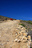 The car on a dirt road on a mountain slope. Greece Stock Images