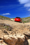 The car on a dirt road on a mountain slope. Greece Royalty Free Stock Photos