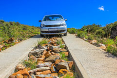 Car in dirt road in Mountain Zebra national park, South Africa Royalty Free Stock Photos