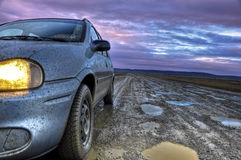 A Car on a Dirt Road in Tierra del Fuego, Argentin. Driving down Route 3 early in the morning in Tierra del Fuego, Argentina Royalty Free Stock Image