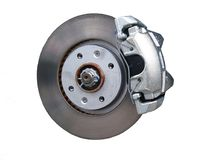 Car disc brake isolated on a white. Close-up of a car disc brake with caliper isolated on a white background Royalty Free Stock Images
