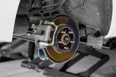 Car disc brake part at tyre in garage royalty free stock photo