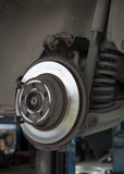 Car disc brake and shock strut absorber. Stock Photos