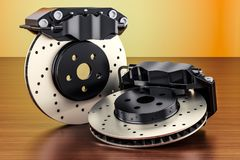 Car discs brake and calipers on the wooden table. 3D rendering. Car discs brake and calipers on the wooden table. 3D Royalty Free Stock Photos