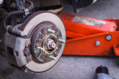 Car disk break after wheel removed Stock Photos