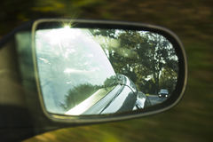 Car with distance in driving-mirror Stock Image