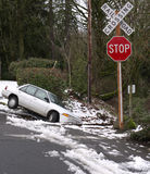 Car in the ditch. Car slipped into the ditch on a snowy day Stock Photo