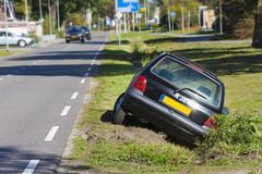 Car in ditch stock images