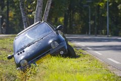 Car in ditch royalty free stock photo