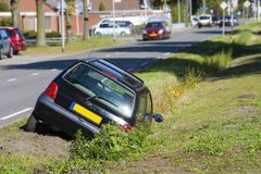 Car in ditch royalty free stock photos