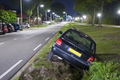 Car in ditch stock photo